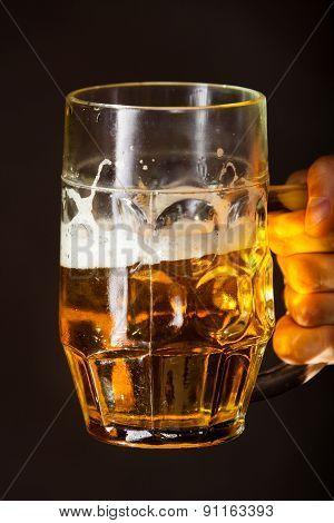 Male Hand Holding Mug Of Beer