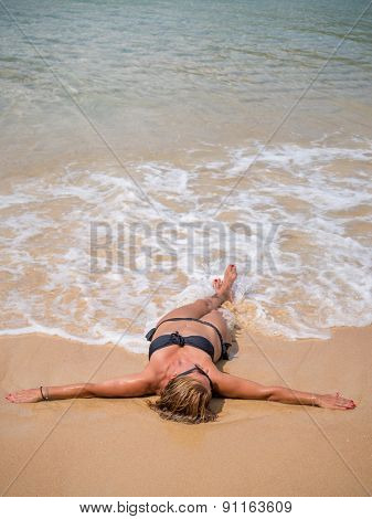 Beautiful woman on the beach in Phuket Thailand.