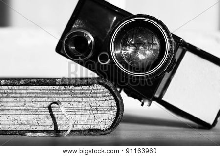 old  camera and a book