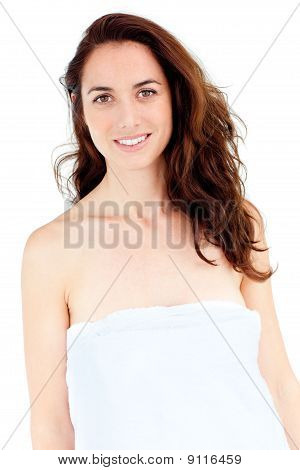Cute Caucasian Woman With A Towel On Her Body Smiling At The Camera