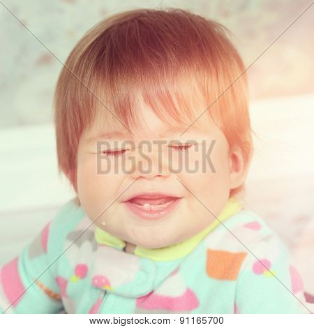 Baby girl laughing with eyes closed - instagram effect