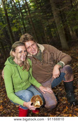 mushroom picking couple
