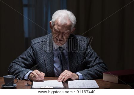 Man Filling The Documents