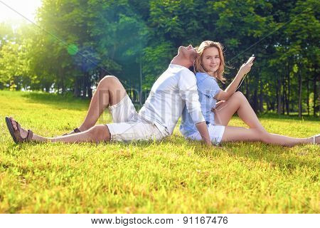 Youth Lifestyle Concept:relaxing Caucasian Coiple Sitting Together Outdoors