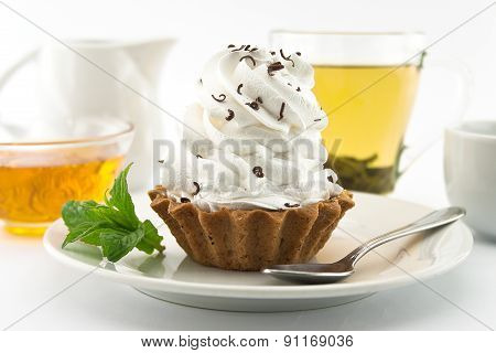 Birthday Cupcake With Mint On Plate With Cup Of Tea. Selective Focus