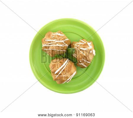 Eclair On Green Plate, Isolated On White Background, Top View.