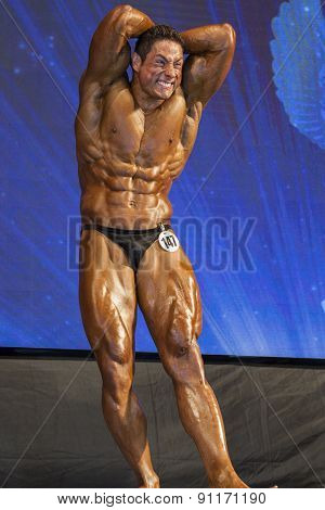 Strong Professional Male Caucasian Bodybuilder Performing On Stage.