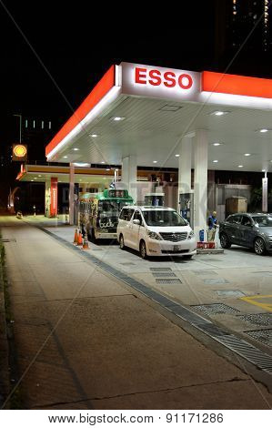 HONG KONG - APRIL 15, 2015: Esso fuel station at evening. Esso is an international trade name for ExxonMobil and its related companies.