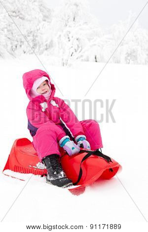 sledding little girl