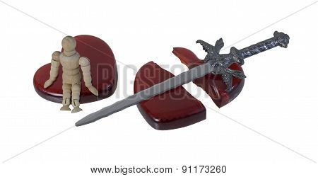 Person Sitting On A Shattered Heart With A Sword