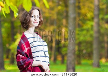 Portrait Of Sensual Smiling Caucasian Brunette Female In The Forest.