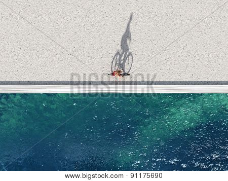woman ride on bike on summer beach