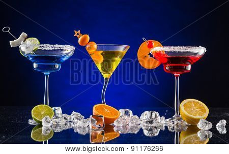 Martini drinks served on bar counter with dark colored background