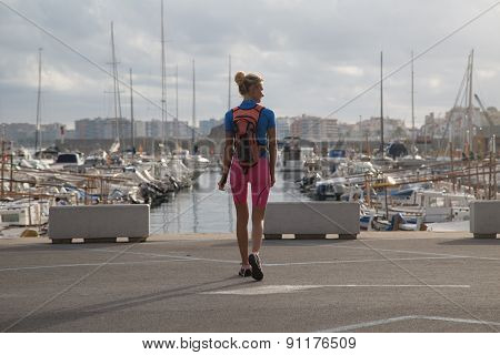 Young Woman Walking In Harbor.