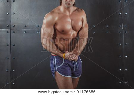 Bodybuilder posing Strong Athletic Man Fitness Model Torso showing big muscles fitness healthy lifes