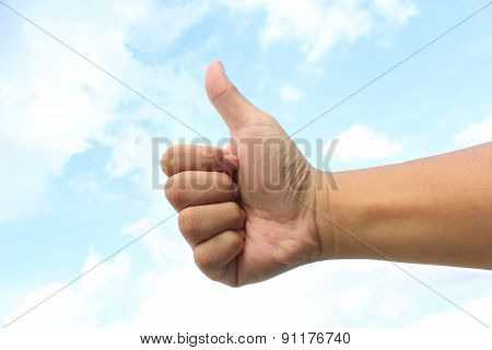 Hand with Thumb up on The Sky Background