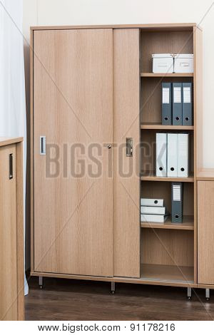 bookcase with folders and boxes in office