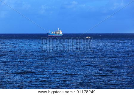 ships and boats in a calm ocean