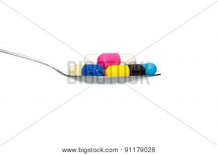 Various Color Medicine Or Capsule On Spoon Isolated On White Background