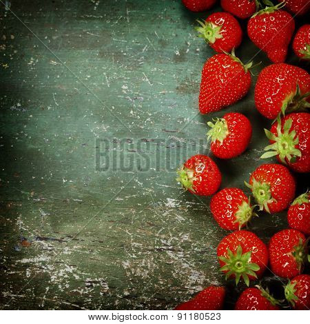 Fresh strawberries on old wooden background. Agriculture, Gardening, Harvest Concept