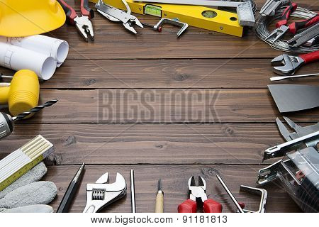 Carpenter Tools on Chestnut Wood Background. Blueprints are not subject to copyright. Words on them are regular like kitchen, bedroom, bathroom etc.