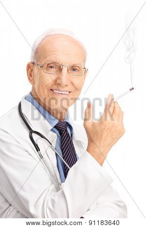 Vertical shot of a mature doctor smoking a cigarette and looking at the camera isolated on white background