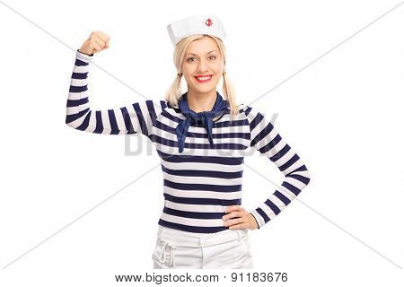 Blond female sailor showing her bicep and looking at the camera isolated on white background