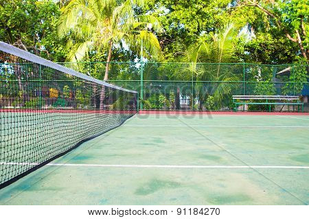 Tennis court on exotic tropical island - sport background