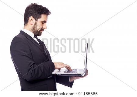 Business man working with a laptop computer, isolated on a white background