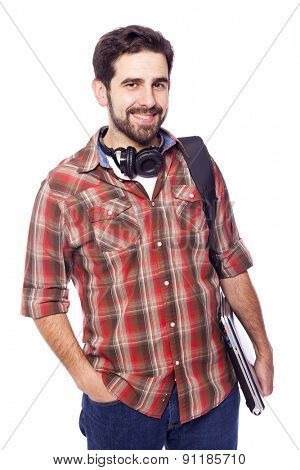 Handsome student holding a laptop, isolated on white background