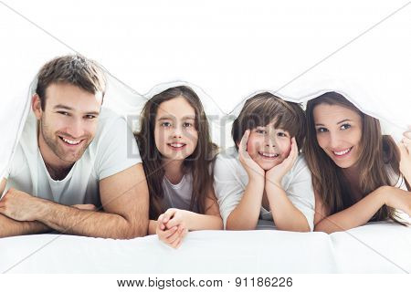 Family lying under the duvet