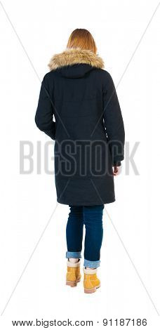 Back view of going  woman in parka. walking young girl. Rear view people collection.  backside view of person.  Isolated over white background. Blonde girl in winter clothes walking slowly away