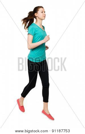 front view of running sport woman. beautiful girl in motion. Sportswoman froze jump.