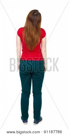 back view of standing young beautiful  woman.  Rear view people collection.  backside view of person.  Isolated over white background. The girl in green pants standing with his hands in his pockets.