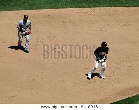 Athletics Coco Crisp Takes Lead With Shortstop Yunel Escobar Behind Him
