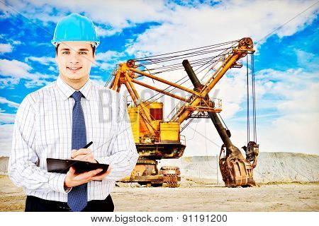 Photo of a mining engineer on industrial background