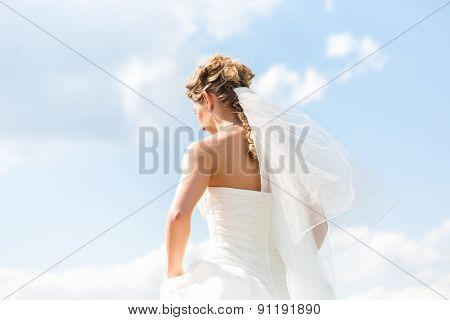 Wedding bride with outside at garden