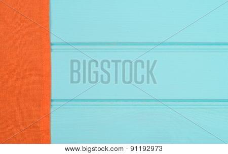 Orange Towel Over Wooden Table