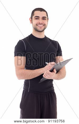 Portrait Of Handsome Trainer In Sportswear With Clipboard Isolated On White