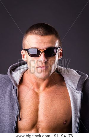 Guy in a sports jacket and sunglasses.