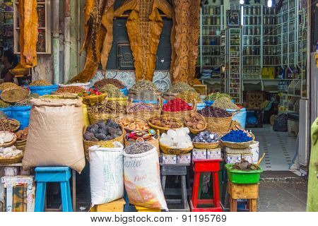 MARRAKESH, MOROCCO, APRIL 4, 2015: Display of natural herbal products and animal leathers (crocodile, snake) in souks