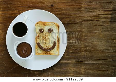 breakfast serving funny face on the plate (toast, chocolate spread)