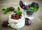 picture of prunes  - sweet milk yogurt with prunes in a glass jar - JPG