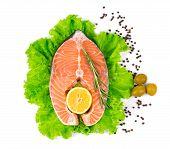 picture of salmon steak  - Fresh salmon steak on lettuce with olives - JPG