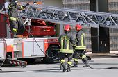 foto of firehouse  - firefighters during an emergency with protective suits and helmets - JPG