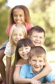 foto of piles  - Group Of Children Piled Up In Park - JPG