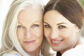 pic of grown up  - Portrait Of Mature Mother Relaxing With Grown Up Daughter - JPG