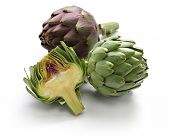 stock photo of half  - whole and half cut artichoke isolated on white background - JPG