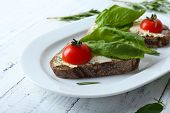 foto of tomato sandwich  - Delicious sandwiches with tomatoes and greens on plate table close up - JPG