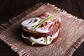 picture of sackcloth  - Sandwiches with lard and onion on sackcloth on table close up - JPG